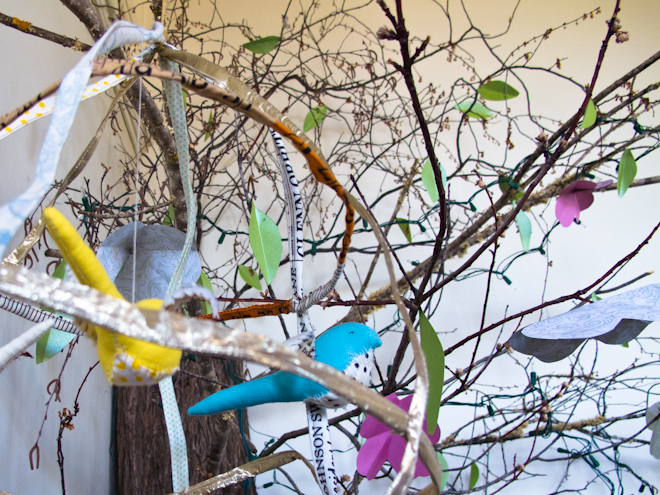 Tree with birds hanging from its branches at the Apples & Jam Playhouse, South Melbourne Commons