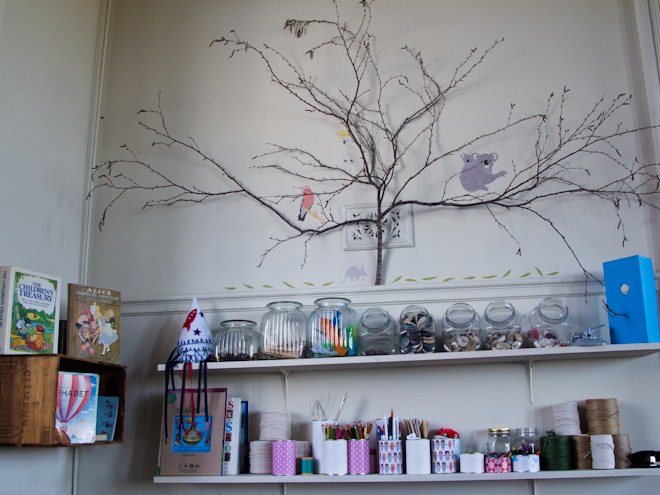 Shelves and tree branches at the Apples & Jam Playhouse, South Melbourne Commons