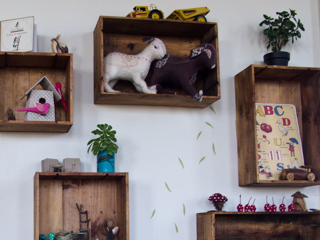 Close up of timber crate shelves at the Apples & Jam Playhouse, South Melbourne Commons