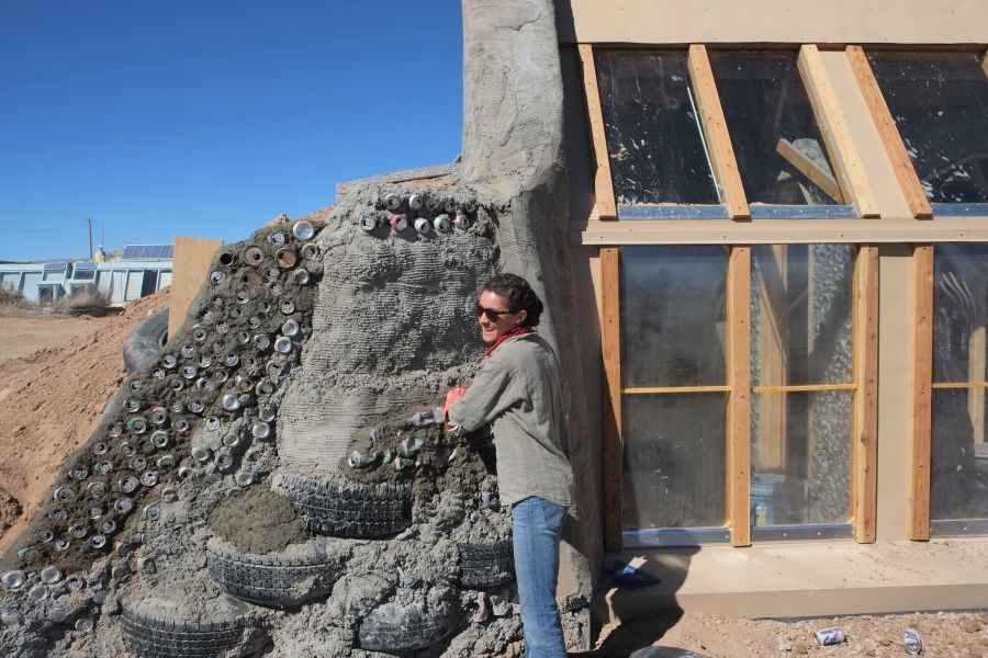 The Desert Echo building an Earthship can retaining wall